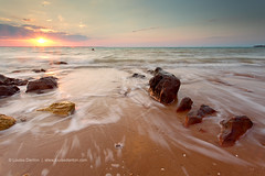 Take me back to the ocean (Louise Denton) Tags: ocean longexposure sunset sea cloud sun beach rocks pretty waves nt pastel australia darwin motionblur flare waterblur rockformation mindilbeach