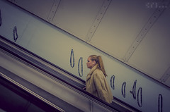 Social climber (lown_c) Tags: woman station digital underground fur nikon coat escalator diagonal d7000