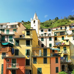 The church bell tower was originally a medieval defensive tower (B℮n) Tags: riomaggiore cinque terre national park quay coast case torri tower houses torre guardiolas path via dellamore coloured buildings mediterranean sea unesco world heritage italianriviera italia cliffs shoreline historic blue sky vacation liguria flowers pink viewpoint hike hiking ocean overlooking vineyards quaint character train boat inspire colors mountainside five sunlight warm weather trees gulf water orange yellew wharf picturesque flower incredible beautiful sail sailing ship bougainvillea church confraternita saint giovanni battista moon 50faves topf50 100faves topf100