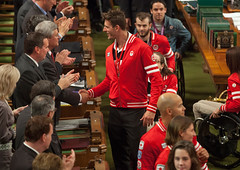 Prime Minister Stephen Harper shakes hands with volleyball player Martin Reader as Canada's Olympic and Paralympic athletes are applauded in the House of Commons for their achievements at the 2012 Summer Olympic and Paralympic Games in London