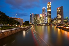 Raffles Place, Singapore (Shutter wide shut) Tags: longexposure reflection skyline singapore cityscape skyscrapers motionblur rafflesplace lightstreak canonefs1022mmf3545usm cloudmovement canoneos7d leesoftndgradfilter