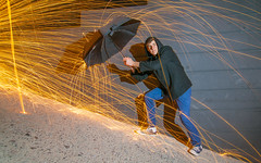 Raining Sparks (Matt G. Harris) Tags: friends light portrait art college wool night digital speed umbrella self canon painting studio fun photography eos rebel photo long exposure paint steel iso ap shutter scottsdale xs prep shutterspeed aperature brophy mgharris