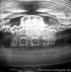 Carousel (Kalou-Kakou (Nikos)) Tags: park uk blackandwhite bw london art film thames analog fun fuji arte nopeople 120film analogue dianaf carusel 38mm 100iso fujiacros100 120back ilfosol3