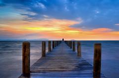 Sunset Pier (roevin | Urban Capture) Tags: cambodia kep sunset sun pier jetty clouds sky symmetry symmetrical twilight boat nightshot islands island sea coast longexposure man silhouette ☆thepowerofnow☆ gettypf