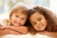 Two 5 year old girls smiling (Tonya B4) Tags: girls little portrait two people 2people children mixedrace caucasian female girl 5yearold together inside indoors leaning sofa couch relaxed casual happy smiling enjoying childhood friends friendship multiracial multicultural horizontal lifestyle atcamera unitedkingdomofgreatbritainandnorthernireland