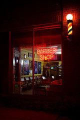 Brownies Barber Shop (slammerking) Tags: barberpole longexposure dark night glass window reflections beautyshop barbershop paintedwindow sign wichita neon