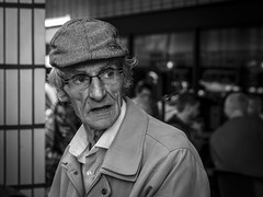 If The Cap Fits (Leanne Boulton) Tags: people monochrome hat depthoffield urban street candid closeup portrait portraiture streetphotography candidstreetphotography candidportrait streetlife old age aged elderly man male cap face facial expression look emotion feeling tension tone texture detail bokeh natural outdoor light shade shadow city scene human life living humanity society culture canon 7d 50mm black white blackwhite bw mono blackandwhite glasgow scotland uk character