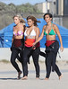 Mollie King, Vanessa White and Frankie Sandford of The Saturdays take surfing lessons on Venice Beach Los Angeles, California