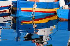 Favignana (vanto5) Tags: travel blue sea italy beach water colors reflections landscape harbor boat europe italia mare sicily fishingboat canoneos350d riflessi favignana reflexiones reflexes isoleegadi canonef24105mmf4lisusm mygearandme