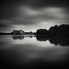 Carew (Andy Brown (mrbuk1)) Tags: longexposure trees cloud building castle water wales contrast reflections river square landscape mono blackwhite mood graphic central perspective shoreline dramatic symmetry llanelli foliage pointofview repetition mirrorimage stark lowkey vignette pembrokeshire mirroring splittone focallength neutraldensity aspectratio 10stop