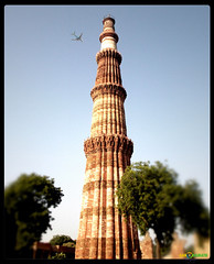 Qutub Minar - UNESCO World Heritage Site in Delhi (Gan$h) Tags: trip travel light red india holiday tree tower stone by lens was nikon sandstone asia tour with minaret delhi indian flight aeroplane coolpix marble complex completed qutub minar tallest constructed  1192 iltutmish aibak qutubuddin l26