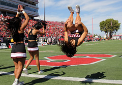 Cheerleaders-A-Poppin' - UNLV vs UNR - Las Vegas, NV (tossmeanote) Tags: las vegas red game college rivalry sport canon geotagged eos rebel back football spring university hand cheerleaders sam stadium nevada skills down nv cheer reno boyd unlv upside 2012 24105 unr poppin gyroscopic 60d intrastate tossmeanote