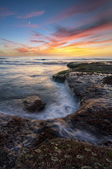 O m k a r a (Lee Sie) Tags: ocean sunset sea sky moon seascape water colors clouds fire coast rocks pacific air tide crescent coastal anemone reef ccl lajollawater