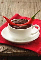 Hot chocolate. (ZakariaSnow) Tags: old winter red food brown white hot cooking cup closeup dark ceramic table dessert pepper spread wooden chili drink sweet linen chocolate napkin spice smooth cream pudding tasty plate vegetable gourmet delicious mug flowing spicy cocoa melted liquid creamy topping ingredient