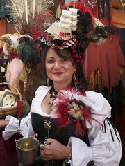 Ren Faire Portrait (davitydave) Tags: red portrait woman hat female costume ship bosom cosplay feathers bust mug recreation renfaire stein societyforcreativeanachronism northerncaliforniarenaissancefaire