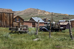 Out in the Field (lefeber) Tags: california wood houses mountains abandoned field grass architecture truck fence landscape town mine decay roadtrip worn ghosttown weathered bodie posts sled sleigh ruraldecay shacks