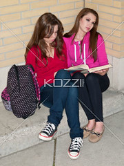 two friends studying together (elisapeople2012) Tags: friends girl beautiful beauty modern female bag reading book togetherness concentration student education pretty sitting friendship fulllength teenagers learning companion studying twopeople casualwear preparations bonding teamwork caucasian schoolbag companionship youthculture casualclothing universitystudent 1617years teenagersonly legscrossedatknee onlygirls personineducation secondaryschoolchild teenagegirlsonly personinfurthereducation