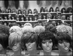 Paramount Wigs   Tampa, FL (robblr) Tags: blackandwhite 120 film analog zeiss mediumformat tampa 645 downtown fuji florida f45 hasselblad neopan tampatheater franklinst acros thehub swc 38mm biogon superwide hc110b a16back robbhohmann