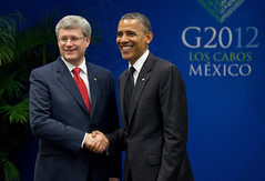 Prime Minister Stephen Harper shakes hands with Barack Obama, President of the United States, after it was announced that Canada would join the Trans-Pacific Partnership (TPP)
