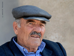 SIDE GLANCE (GREECE, PELOPONNESE) (KAROLOS TRIVIZAS) Tags: portrait man face look hat person eyes expression oldman moustache greece kangol physiognomy peloponnese digitalcameraclub blinkagain tragiaska