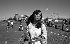 Street portraits (__ _) Tags: portrait motion girl contrast pose asian helsinki eyecontact skies candid streetphotography atmosphere feeling ilford citycentre decisivemoment panf younglady streetportraiture tonalrange tonality microphen canoneos1n