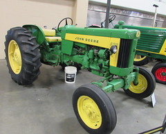 1951 John Deere 430 Tractor. (dccradio) Tags: fayetteville nc northcarolina cumberlandcounty cumberlandcountyfair fair countyfair festival communityevent entertainment fun event crowncomplex civiccenter ag agriculture agricultural farmequipment machinery equipment implements tractor tractors farmmachinery vintage classic antique old 1950s johndeere 430 green yellow plants flowers ribbons decor decorations