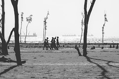 Approaching with joy!! (Ajwad Mohimin) Tags: frame monochrome blackandwhite bangladesh bangladeshi bay beach sea seashore shore boys group chittagong canon canon60d child candid 50mm ngc