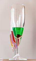 Verres colorés-3 (Au Fil Des Caprices (photographer & model)) Tags: orange jaune rouge violet vert reflet pied blanc transparence verres liquide penchés hautelumière