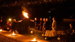 Mayor Angel Taveras receiving the flame at WaterFire Roma