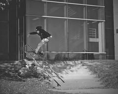 Zach Horkan - Front Boardslide (Winglemire) Tags: white black photography 50mm photo nikon skateboarding michigan flash rail front skate nikkor boardslide strobe offset d90