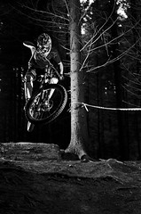 Downhill #11 bw [explored] (Michael-Herrmann) Tags: wood trees bw black tree fall forest blackwhite jump nikon ride air drop downhill sw nikkor root mountainbiking ri