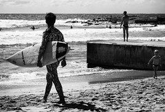 Wet Suit Parade (Julie Byrnes) Tags: blackandwhite beach blackwhite noiretblanc candid streetphotography australia deewhy streetimages beachproject juliebyrnes