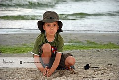 Boy playing with sand | Black Sea Beach (Stefan Cioata) Tags: boy sea summer baby beach water beautiful hat childhood person photography one photo sand europe child play image cloudy sale great stock best explore romania getty top10 playful available constanta outstanding 5years flickrandroidapp:filter=none playhood