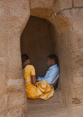 Couple Of Midadult Person Sitting On The Edge Of A Window Cut In Rock, Mahabalipuram, India (Eric Lafforgue) Tags: people india colour smart outside outdoors couple day quiet jewellery indoors indie earrings rearview mustache hindu indi groupofpeople sari blackhair blueshirt indien hind tamilnadu indi inde mahabalipuram mamallapuram hodu darkhair indland welldressed  hindistan headdown indija   backagainstthewall ndia hindustan indianpeople  6611 waistup  twoadults   twoperson goldenwatch hindia  bhrat  indhiya bhratavarsha bhratadesha bharatadeshamu bhrrowtbaurshow  hndkastan       midadultperson windowcutinrock