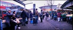 The Bus Stop (*monz*) Tags: street panorama streets color colour bus film fruits vegetables iso200 birmingham fuji market pavement superia panoramic stop widelux shelter rag f28 openair brum f7 c41 26mm monz explored panon