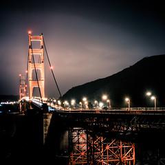 Golden Gate Bridge (lalush.com) Tags: ocean sanfrancisco california longexposure winter water clouds sunrise bay illumination calm goldengatebridge nd coastline