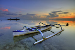 A Warm Sunrise [Explore] (Pandu Adnyana (thanks for 100K views)) Tags: bali beach sunrise indonesia boat bale pantai sanur karang