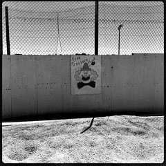 The Clown (pam's pics-) Tags: nebraska benkelmannebraska pamspics pammorris midwest us usa america carnival amusements amusementpark dundycountyfair bw clown abandoned appleiphone cameraphone mobilephonephotography hipsta hipstamatic
