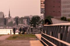Enjoying the evening sun, the city and a beer (JayPiDee) Tags: architektur dof flickrfotowalk220716lzbinderhafencity frau gelnder leute menschen person sigma sigma70300mmf456dgos sigma70300dgos architecture people railing woman hamburg deutschland