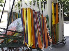 (El Papasfritas) Tags: colores colors ribbons listones carretas hamacas hammocks