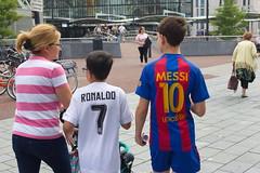 Family feud? (chipje) Tags: street family boys shirts ronaldo messi rotterdam blaak netherlands