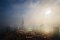 Foggy sunrise in Dubai #6 (momentaryawe.com) Tags: fog buildings dubai uae roundabout foggy middleeast surreal unitedarabemirates catalinmarin momentaryawecom burjkhalifa
