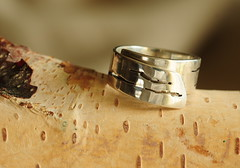 the birch bark ring (anniedaisybaby) Tags: pierced winnipeg cut ring filed polished rolled formed sterlingsilver sawed drilled metalarts artimitatinglife goldsmithing wrapring birchbarkdesign