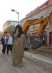 Woman in front of a bulldozer in Kashgar Xinjiang China (Eric Lafforgue) Tags: china  kina chin cina chine xina   tiongkok  chiny  kna in   trungquc na   kitajska tsina       chinacinachinechinyincinanakinaknakitajskationgkoktrungquctsinaxinachin