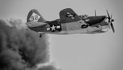 Through the smoke! SB2C Helldiver (Bill Jacomet) Tags: show bw white black field plane wings texas air over houston airshow planes and 2012 ellington helldiver sb2c