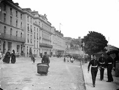 Queenstown aka Cobh (National Library of Ireland on The Commons) Tags: ireland cork trumpet shops queenstown cobh munster pram sidecar perambulator glassnegative lowerroad cornet commodorehotel queenshotel robertfrench williamlawrence nationallibraryofireland lawrencecollection bootshoewarehouse valetudinarian
