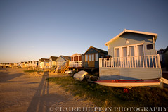 (Claire Hutton) Tags: uk winter sunset two people sun cold beach boat sand couple shadows spit sunny before huts dorset beachhut mudeford lowsun hendgistburyhead