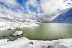 snow on the white lake - Lago Bianco (2234m) Engadin (gregor H) Tags: winter sun mountain snow landscape cloudy sunny reservoir engadin swizerland greenwater carlzeiss pontresina graubnden zf lagobianco icywater berninapass distagont3518