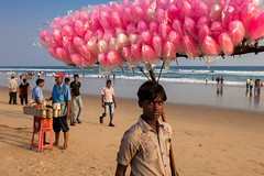 Cotton candy, Puri (Marji Lang) Tags: ocean travel pink light boy sea portrait people food india holiday beach colors rose horizontal youth composition work daylight eyes sand colorful afternoon looking candy shot image candid indian working perspective young streetphotography documentary beautifullight sunny beachlife scene sugar cotton cottoncandy worker gaze candies plage orissa indien couleur inde regard puri barbapapa bayofbengal indianboy travelphotography republicofindia barbepapa indianpeople peopleonthebeach childwork ef247028l indiansubcontinent sucreries puribeach  youngworker canoneos5dmarkii indianholidays odisha bhrat travelanddocumentaryphotography  marjilang pinkcandies youngseller