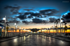 St. Pete Pier Under Ominous Skies (Vladimir Illich) Tags: road street morning brick gulfofmexico water clouds sunrise stpetersburg outdoors dawn pier nikon wind tampabay florida streetlights 28mm ngc perspective scenic hdr linearperspective pinellascounty photomatix nikor centralperspective stpetepier d5000